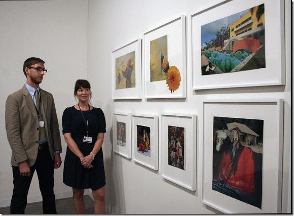 Curator Nelson Hollenquist and Gavlak Gallery owner Sarah Gavlak discuss the work of Phillip Estlund at Art Basel.(Photo by Katie Deits)
