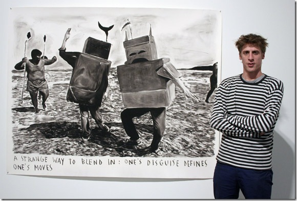 "Rinus Van de Velde with his drawing ""A Strange Way to Blend In."" (Photo by Katie Deits)"