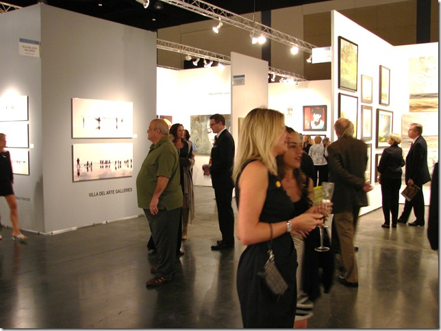 Visitors to the Art Palm Beach preview Thursday take in the galleries of contemporary art. (Photo by Jenifer M. Vogt)