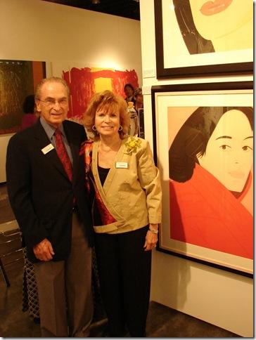 Edward and Sandra Neustadter stand next to Alex Katz's 'Brisk Day.' (Photo by Jenifer M. Vogt)