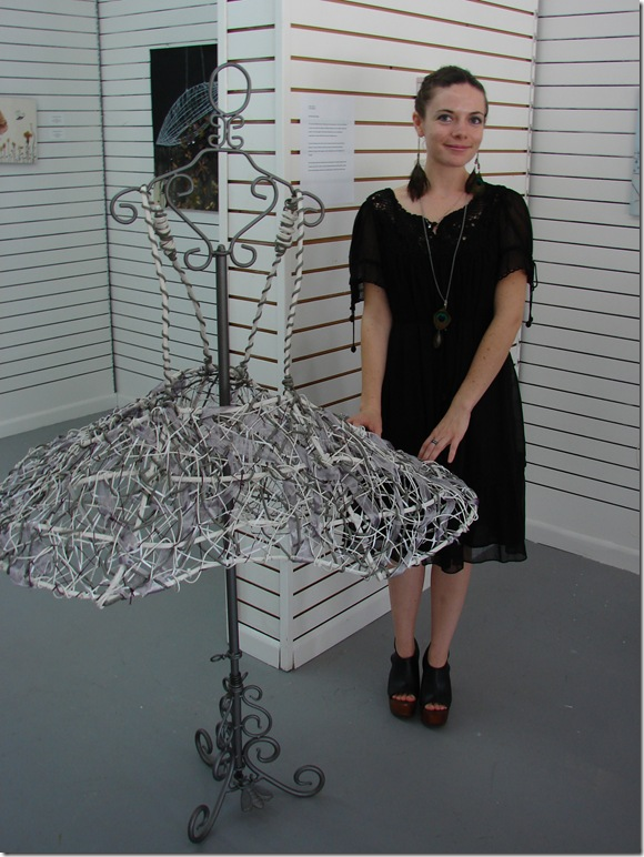 Performance and mixed-media artist Jackie Tufford stands amid her series She Wore Wire Dresses (2011). (Photo by Jenifer M. Vogt)