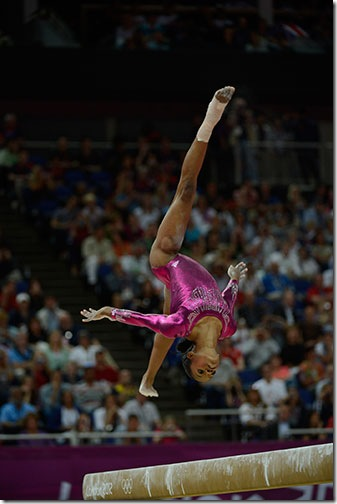 Gabrielle Douglas competes on the balance beam during the women's all-around gymnastics competition, in which she won the gold. (Photo by Adam Stoltman)