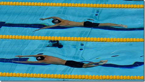 Michael Phelps and Ryan Lochte compete in the semifinals of the 200-meter individual medley. (Photo by Adam Stoltman)