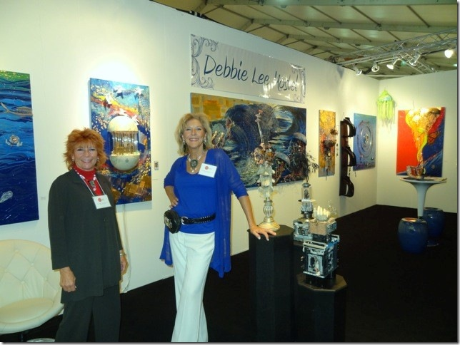Artist Debbie Mostel (right) with her sister Bonnie in her booth at Red Dot. (Photo by Katie Deits)