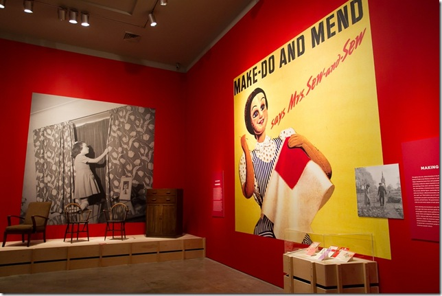 A poster with the slogan 'Make-Do and Mend,' at the Keep Calm and Carry On exhibit.