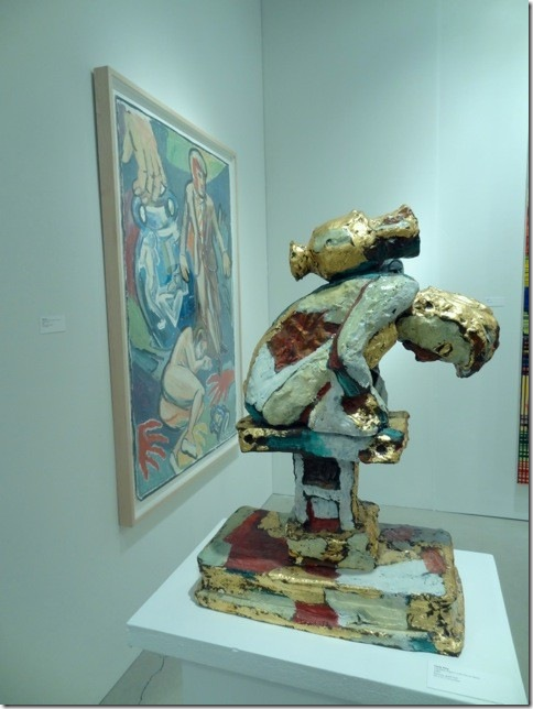 A painted bronze sculpture and an acrylic and oil painting by Viola Frey. (Photo by Katie Deits)