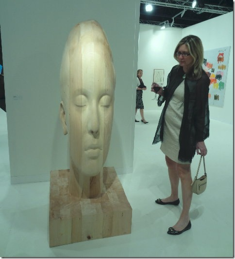 Susan Bardin of Tequesta views Marianna H., by Jaume Plensa. (Photo by Katie Deits)