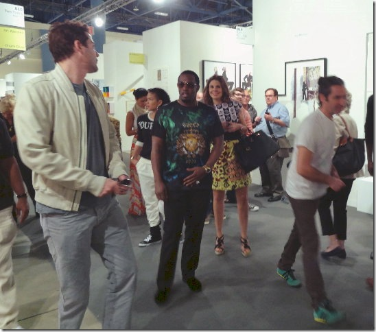 Entertainment mogul and part-time Miami Beach resident Sean Combs (center) checks out the Art Basel scene. (Photo by Katie Deits)