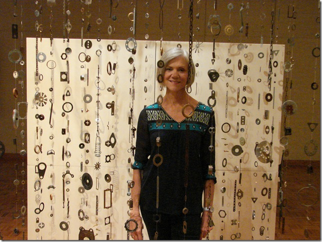 Artist Karla Walter, with Elayna Toby Singer's 'Going Within.' (Photo by Jenifer Mangione Vogt)