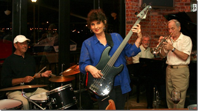 Susan Merritt, playing bass with her band. (Palm Beach ArtsPaper file photo by Katie Deits)