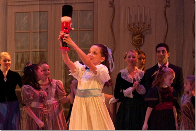 Clara admires the Nutcracker in a scene from the Ballet Palm Beach production.
