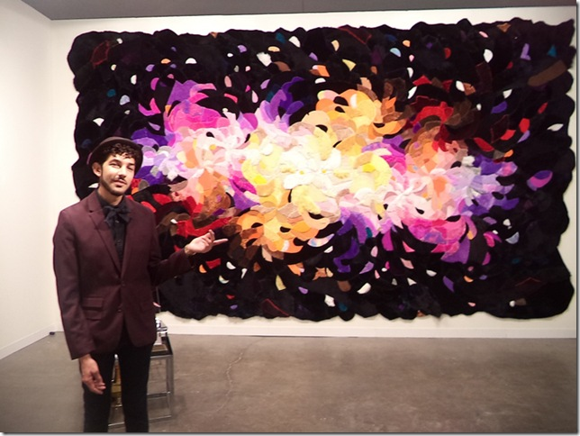 Gallery owner Anthony Spinello with a tapestry by Agustina Woodgate (Photo by Katie Deits).