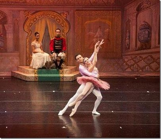 Sarah Smith and Roman Zhurbin as the Sugar Plum Fairy and the Cavalier, in Boca Ballet Theatre's production of The Nutcracker. Seated at back is Sasha Lazarus as Clara. (Photo by Silvia Pangaro)