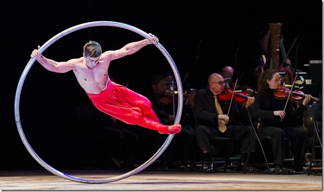 Vitalii Buza of Cirque de la Symphonie performs on the spinning frame. (Sherry Ferrante Photography)