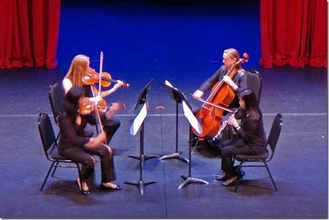 Clockwise from left: Mei Mei Luo, Rene Reder, Susan Moyer Bergeron and Erika Yamada play Mozart's Oboe Quartet at the Palm Beach Chamber Music Festival.