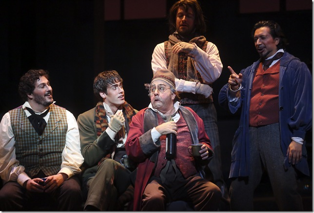 "Anthony Kalil as Rodolfo, Tobias Greenhalgh as Schaunard, Thomas Hammons as Benoit, Evan Boyer as Colline and Luis Ledesma as Marcello in Act I of ""La Bohème."""