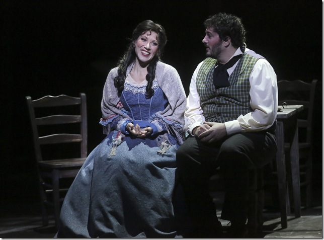 "Eleni Calenos as Mimì and Anthony Kalil as Rodolfo in ""La Bohème."""