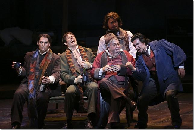 """Dimitri Pittas as Rodolfo, Tobias Greenhalgh as Schaunard, Thomas Hammons as Benoit, Evan Boyer as Colline and Luis Ledesma as Marcello in Act I of """"La Bohème."""""""