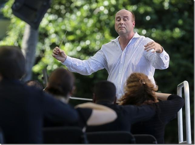 Palm Beach Opera chorus master Greg Ritchey led the proceedings Saturday.