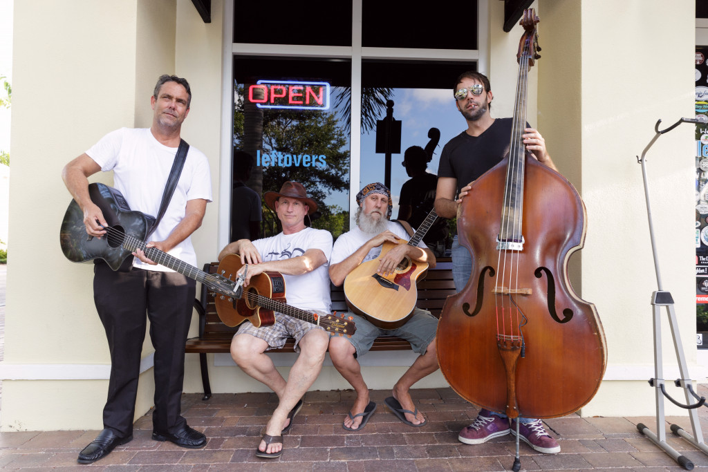 The String Assassins, outside Little Moir's Leftovers Café in Jupiter. From left: Matt Gill, Dr. Jay Kuchera, Mark Shubert and Zak Mahoney. (Photo by Tom Tracy)