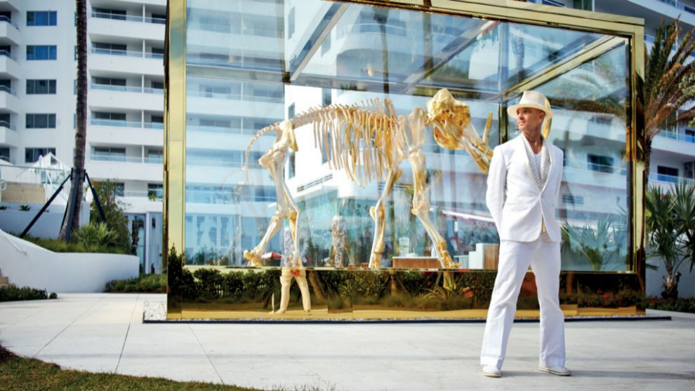 Alan Faena in front of a Damien Hirst sculpture.