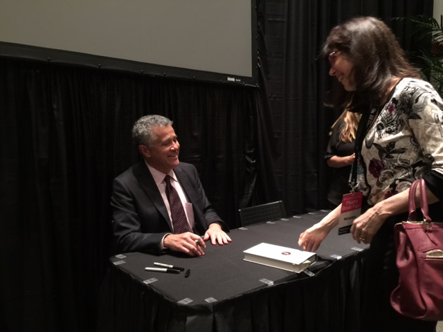 Jeffrey Toobin signs books Thursday night at the Miami Book Fair. (Photo by Chauncey Mabe)