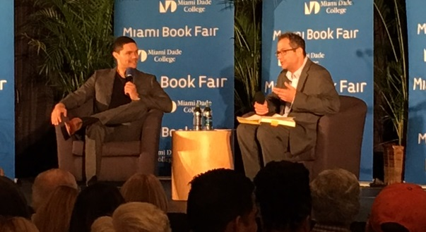 Trevor Noah (left) is interviewed Sunday night at the Miami Book Fair by Robert Weisberg. (Photo by Chauncey Mabe)